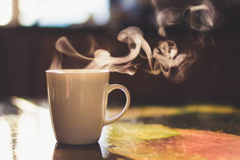 Close Up Of Steaming Cup Of Coffee Or Tea On Vintage Table   Early Morning Breakfast On Rustic Background