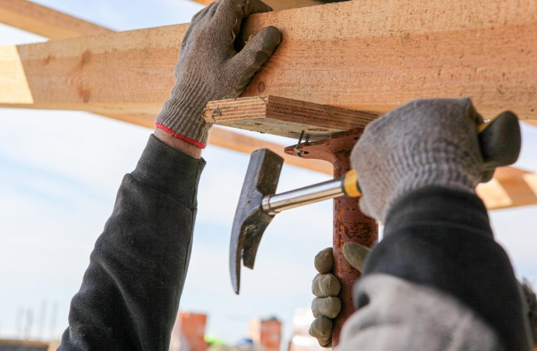 Construction Worker Build A Construction From Wooden Beams