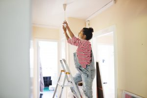 Pregnant Young Woman Renovating Home