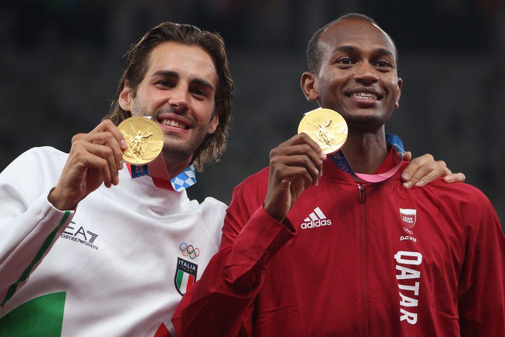 Medalla de oro compartida impactante Juegos Olímpicos
